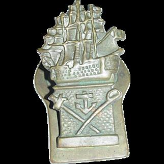 Vintage Brass Paper Clip Paper Holder Embossed Ship w Cross Swords & Anchor
