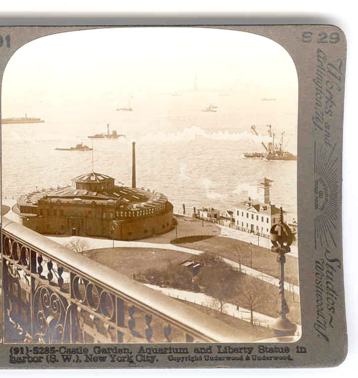 c1896-1920 Castle Garden New York City Stereo View - 19th Century United States Immigration Center -  20th Century City Aquarium - Battery Park Foreground - Statue of Liberty & New York Harbor Background - Underwood Real Photo View