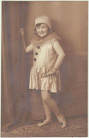 Sweet Girl in Carnival Costume: Columbine. Studio Photo.
