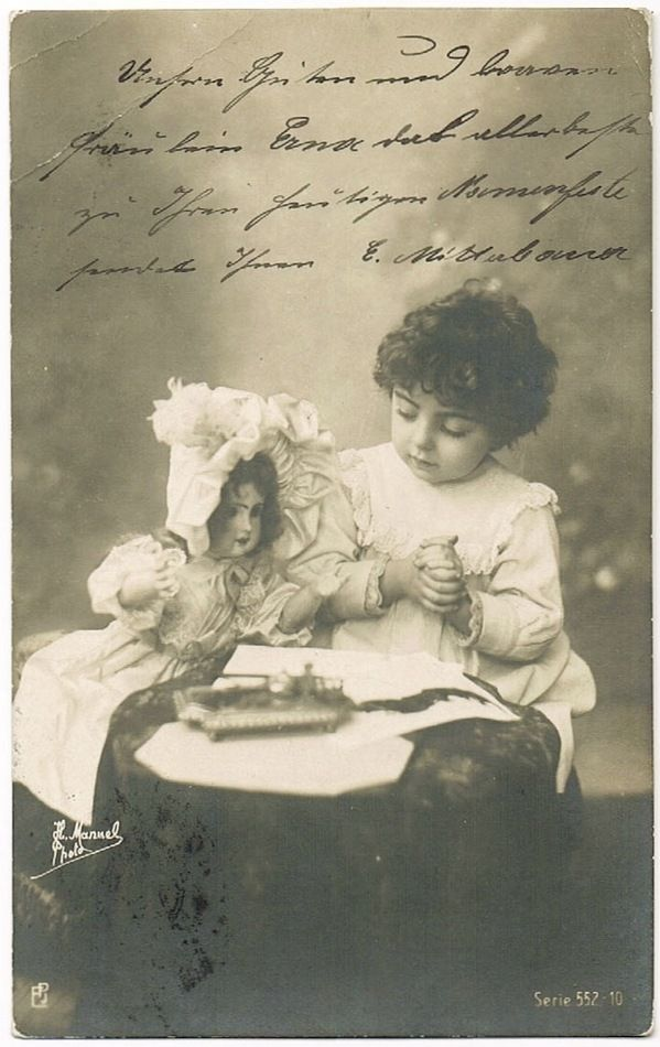 Girl with Doll. Vintage Photo Postcard from 1905