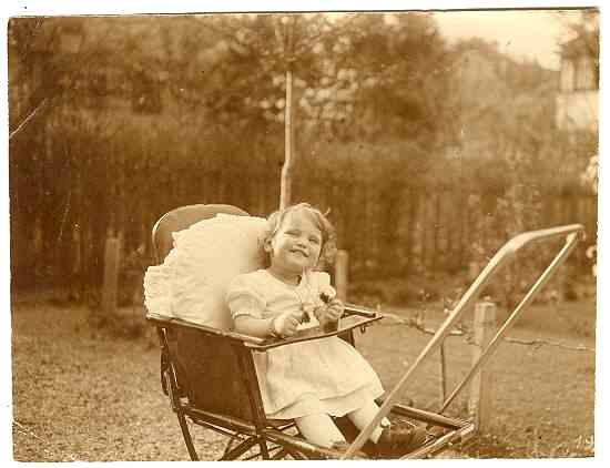 Ca. 1915: Two vintage photos of a Girl in a Pram
