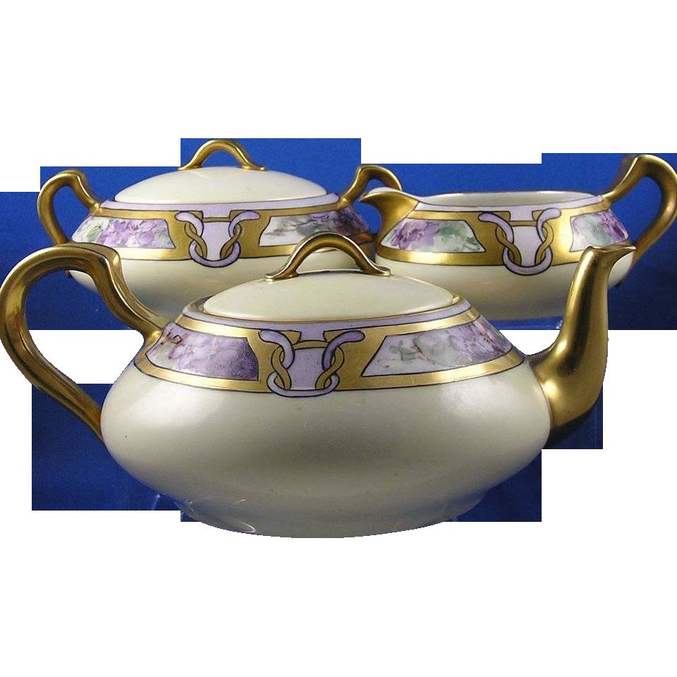 """Haviland Limoges Arts & Crafts Violet Motif Tea Set - Teapot, Creamer & Sugar (Signed """"Edna S. Arthur San Francisco""""/Dated 1920)"""