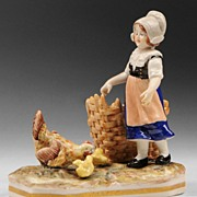 Porcelain figure of girl with chickens