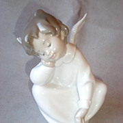 Charming Porcelain Lladro Sitting Angel Figurine