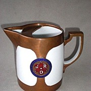 Fabulous Copper Clad Pottery Advertising Pitcher
