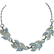 Elegant Articulated Silvertone and Deep Blue Rhinestone Necklace