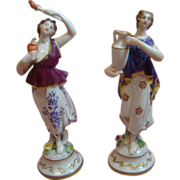 Pair of Porcelain Figurines Holding Torch and Urn (Fire and Water)