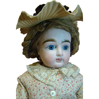19 In. Bisque Turned Shoulder Head, Closed Mouth with White Space Between Lips, Antique Clothes and Human Hair Wig