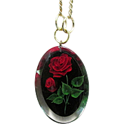 "Necklace with Embedded Roses in Lucite Pendant on 16"" Chain"