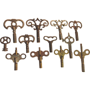 SALE 12 Ornate Antique Clock Keys