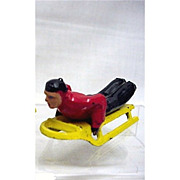 SALE Toy Figurine Man on Sled  Miniature Winter Toy