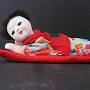 Oriental Doll on Pillow