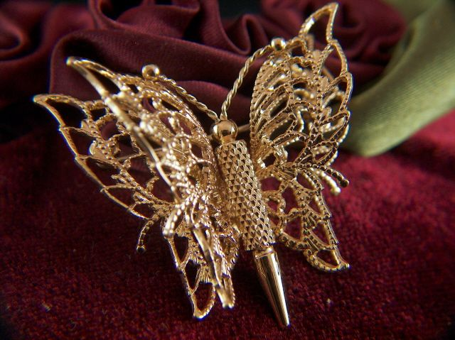 Vintage signed MONET Filigree Gold Toned Butterfly Brooch Pin