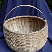 Antique Basket Made of Oak Splints with Bent Handle.