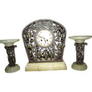 An Unique French Art Nouveau Wrought Iron Clock Set, from circa 1920.