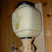 A Vintage Porcelain Iron Wall Mount Coffee Grinder