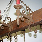 A large wooden / wrought-iron 6-light castle chandelier