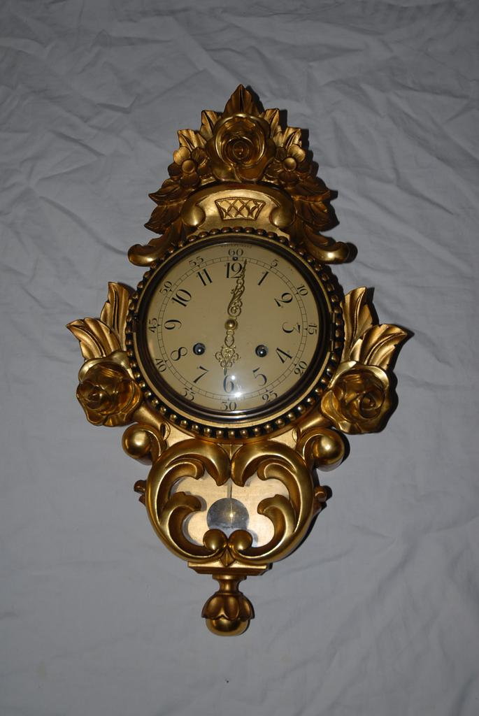 A Beautiful Old Swedish Gilt Carved Wooden Wall Clock