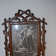 An Antique Finest Carved Wood Black Forest Picture Frame