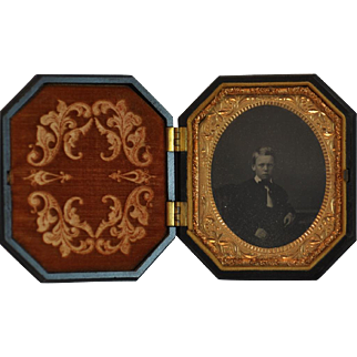 Ambrotype of Young Boy in Highly Carved Octagonal Thermoplastic Union Case by S. Peck Company