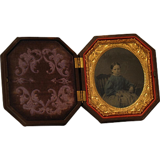 Hand Tinted Ambrotype of Young Girl in Highly Carved Octagonal Thermoplastic Union Case by S. Peck Company
