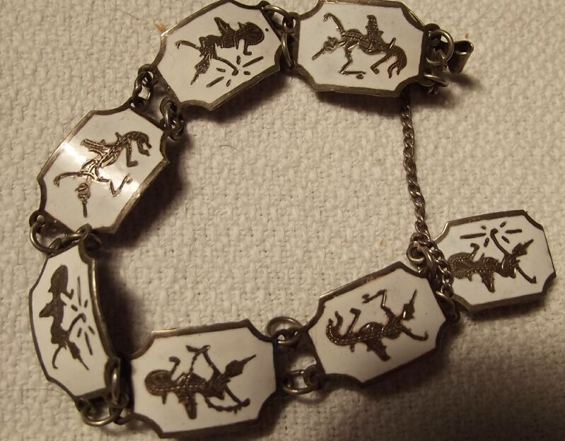 Sterling Bracelet With White Enamel and Siam Figures