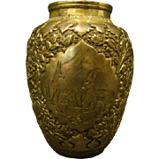 Ornate silverplate vase with deer rabbits and birds