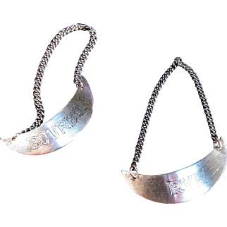 Two Sterling Bottle Tags