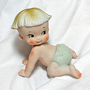 German Bisque Crawling Piano Baby Figurine