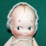 Old All bisque Kewpie Doll with Bonnet & Free tiny companion