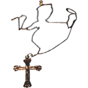 Cross on a very slender chain