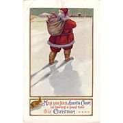 "Christmas Postcard "" Santa "" carrying his bag with goodies, walking through the Snow"