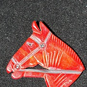 Vintage Red Bakelite Hand Carved Horse Head Brooch