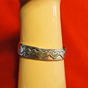 Sterling Silver Hand Hammerd Cuff Bracelet with Raised Hearts