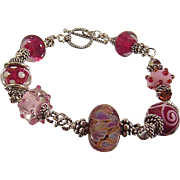 Pampered in Pink: Hand Twisted Sterling Silver and Lampwork Bead Bracelet