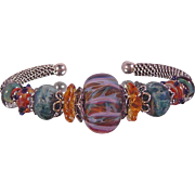 Tahitian Sunrise: Hand Woven Sterling Silver and  Lampwork Beaded Bracelet