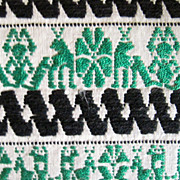 Dresser Scarf, Green and black embroidery on a fine cotton background,  Stylized green figures, black zigzag pattern 50s