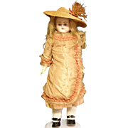 Beautiful Antique doll with a wonderful dress