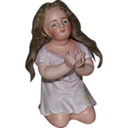 All Bisque German Figurine of Child on Her Knees