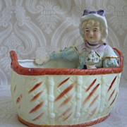German All Bisque Victorian Girl in Wicker Basket