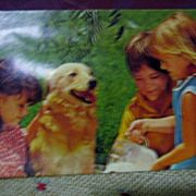 Souvenir Squeak Postcard Children and Golden Retriever