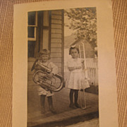 Early 1900s RPPC Boy with Tuba Girl with Trombone