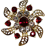 Dimensional Red and Clear Rhinestone Gold Tone Floral Shaped Brooch Pin with Pierced Leaves