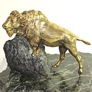 Wonderful gilded bronze sculpture of a buffalo on a rock