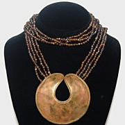 SALE 1970s Brass Medallion & Amber Glass Bead Necklace