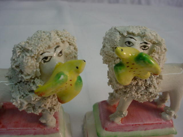 Matched Pair Staffordshire Poodle with Bird Figurine
