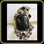 Sterling Silver Broach/Pendant with Labradorite Accented by Amethyst,Garnet and Blue Topaz