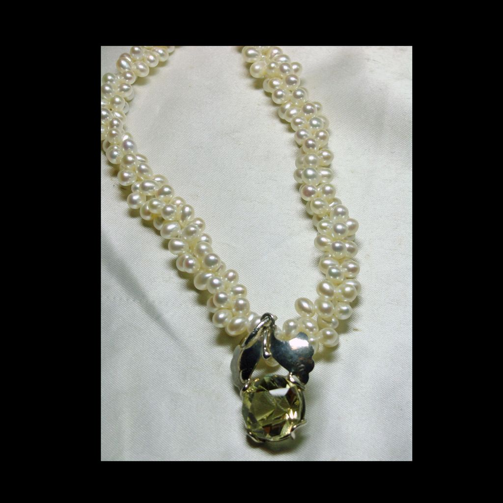 Twisted Necklace Of Pearls with a Sterling Silver and Yellow Kunzite Pendant