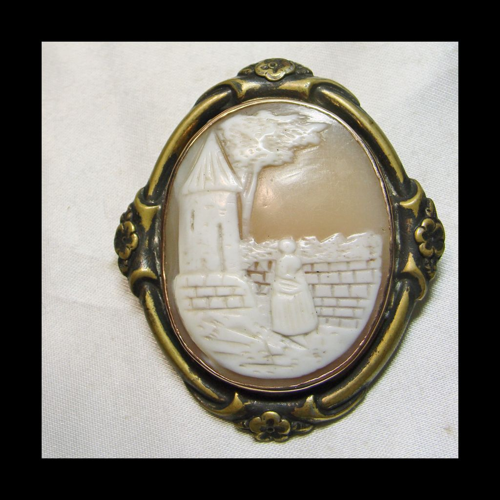 Variation of Rebecca at the Well Cameo set in a Brass Frame Like Setting