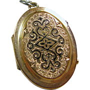 Victorian Locket with Gold Front and Back Decorated with Black Enamel
